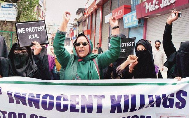 Activists of Kashmir Tahreek Khawateen shout slogans during a protest against the killing of civilians at Handwara on Friday.