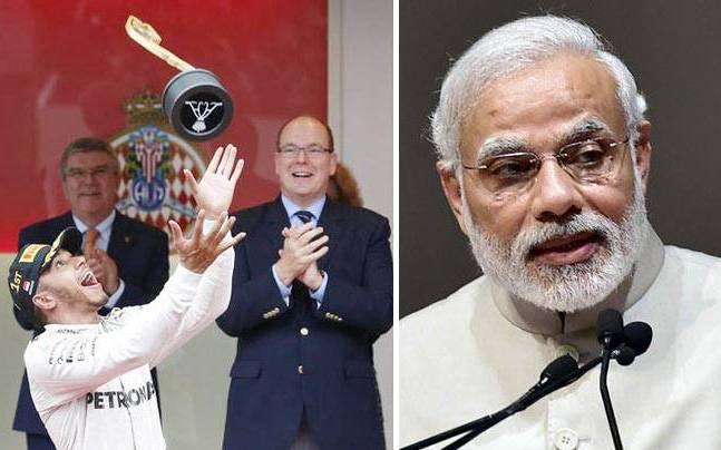 Lewis Hamilton (left), PM Modi