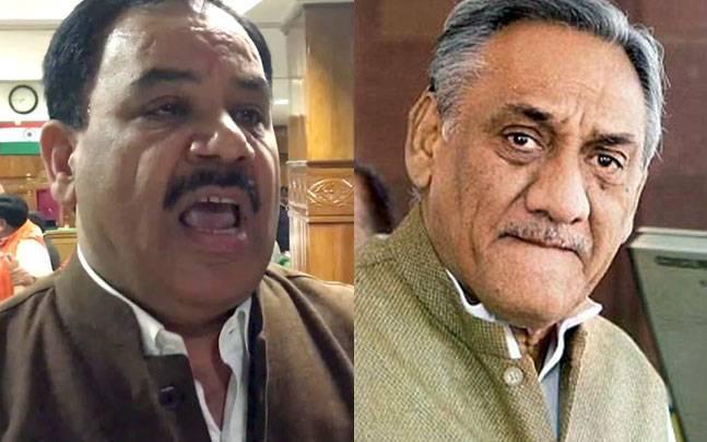 Harak Singh Rawat (left) and Vijay Bahuguna