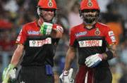 Virat Kohli battles injury to lead Royal Challengers Bangalore to thumping win over Kolkata Knight Riders