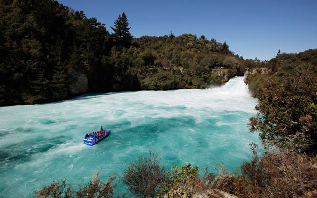 Visitors on a jet boat take in the sights of Taupo's Huka Falls on the Waikato river. Taupo is known for its scenic beauty and outdoor activities. Photo: Reuters