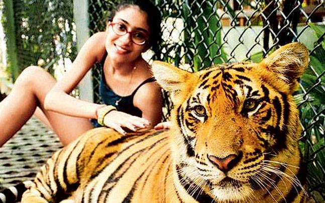 Sushmita Sen's daughter Renee posing with a tiger. Sen is currently on a vacation with her daughters in Thailand.
