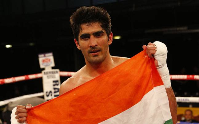 Vijender Singh holds the Indian national flag