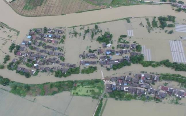 An aerial view shows that houses are flooded in villages in Wuxi, Jiangsu Province, China (Photo:Reutes)
