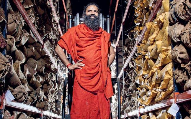 Baba Ramdev in the herb warehouse at Haridwar's Patanjali food park