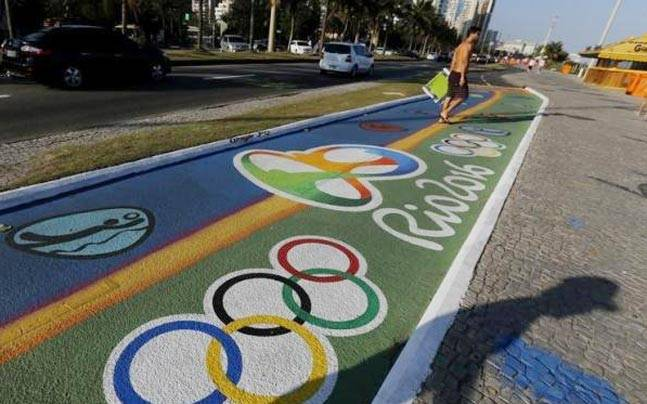 A man walks past a newly-painted bicyle lane ahead of the Rio 2016 Olympic games near Barra da Tijuca beach in Rio. (Reuters Photo)