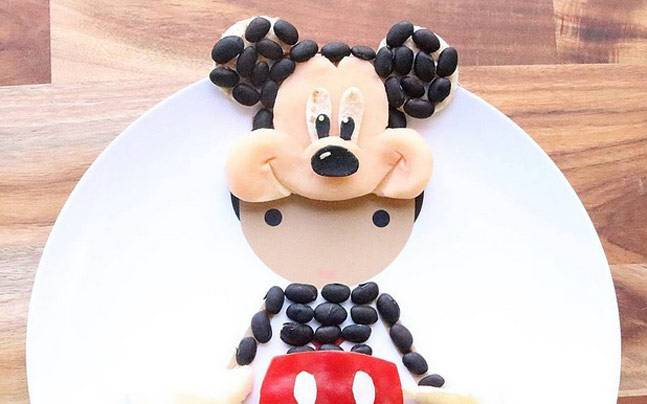 Mickey Mouse food art using prawn dumplings with black beans, red capsicum, potato and corn. Picture courtesy: Instagram/jacobs_food_diaries