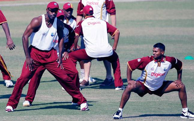 Chris Gayle and Shivnarine Chanderpaul with other West Indies cricketers