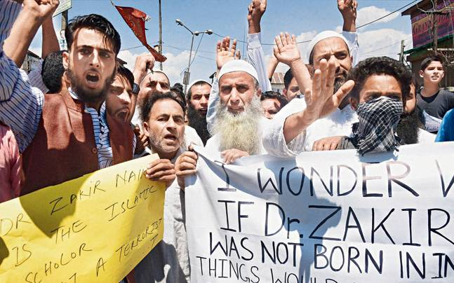 Supporters chant slogans and hold placards during a protest march in favour of Islamic scholar Zakir Naik in Srinagar on Friday.