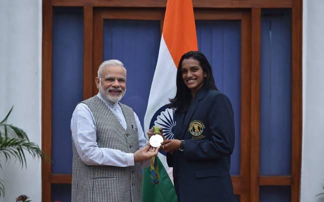 PM Narendra Modi with PV Sindhu