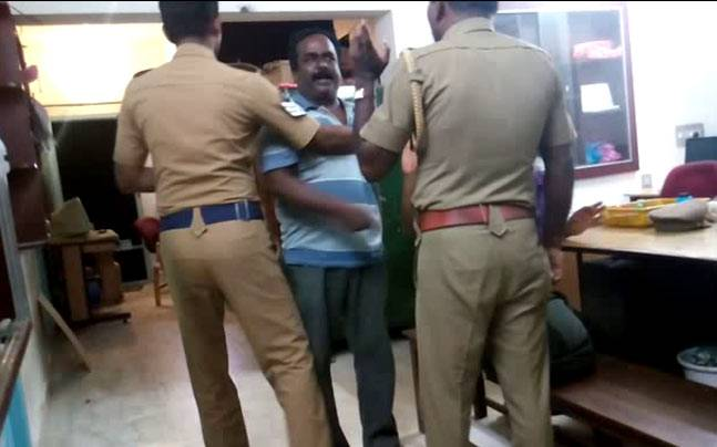 Drunk men scuffle at police station