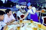 Waitresses dressed in blue and white uniforms serve beer at North Korea's first beer festival. Picture courtesy: Instagram/explore_dprk