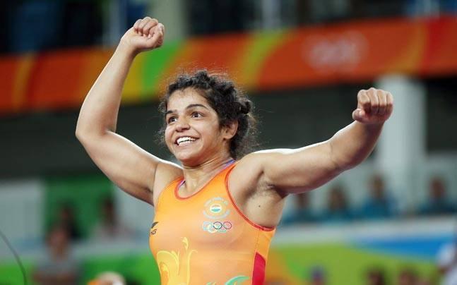Sakshi Malik celebrates her win.