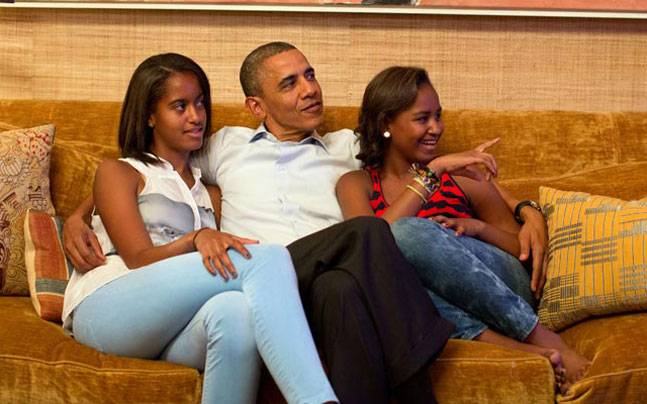 President Obama with his daughters Sasha and Malia