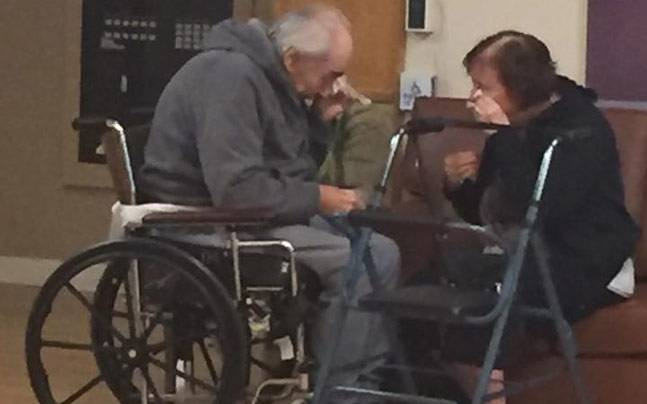 Elderly couple saying goodbye after 62 years of togetherness