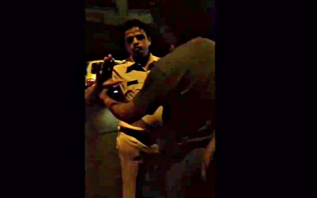 Mumbai policemen harass a group of men