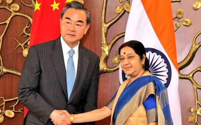 Sushma Swaraj meets her counterpart Chinese FM Wang Yi