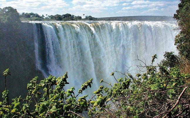 The Victoria Falls can be explored on foot or on a helicopter ride