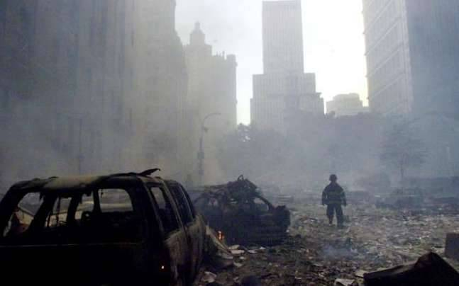 A firefighter walks amid rubble near the base of thedestroyed World Trade Center in New York on September 11, 2001. (Photo: Reuters)