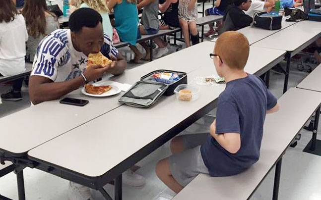 Going Viral: Florida mother's photo of her lonely autistic son eating lunch with a football player