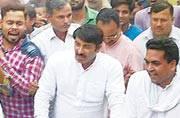 Manoj Tiwari's tango with AAP minister who termed Modi an 'ISI agent' irks BJP