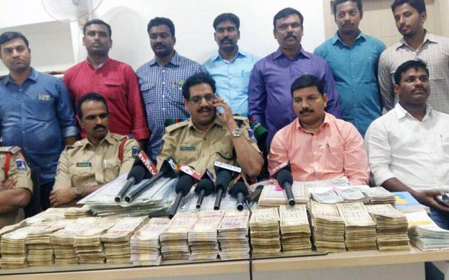 The police with the seized money