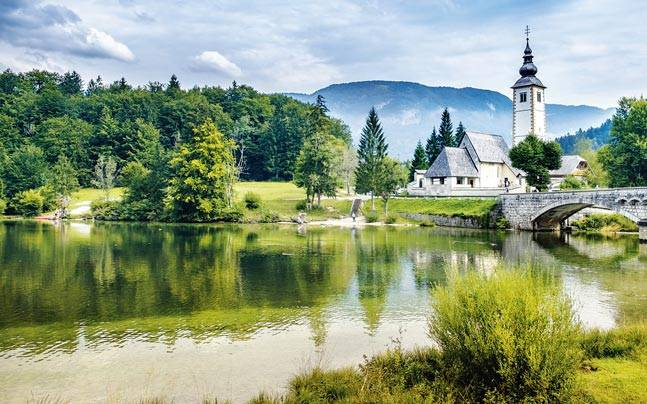 Lake Bohinj in Slovenia offers a picture-perfect Alpen landscape with great walking and cycling trails. Picture courtesy: Mail Today
