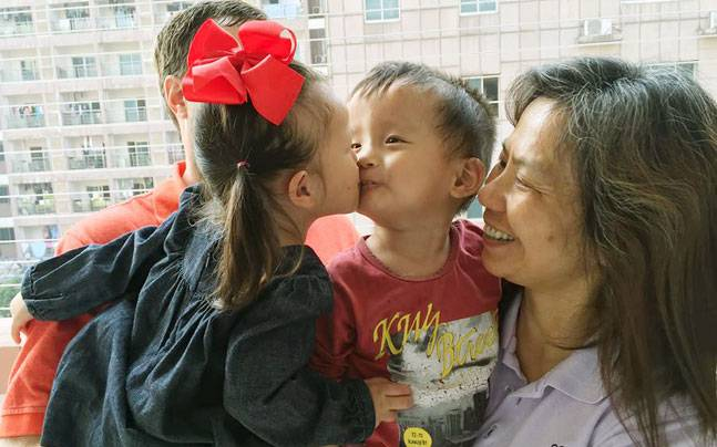 Adoption helps Chinese orphans reunite after two years