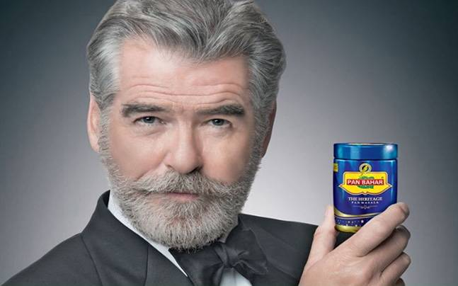 Pierce Brosnan posing with a pan brand