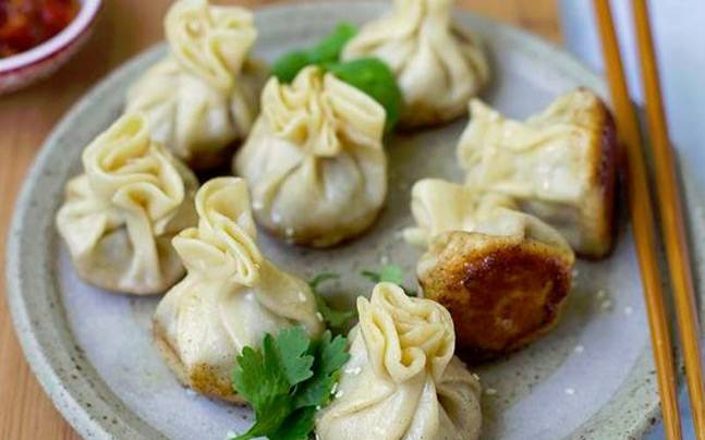 Who doesn't like to snack on delicious, steamed or fried momos? Picture for representational purpose. Picture courtesy: Pinterest/Sarah The Sugar Hit