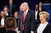 Republican presidential nominee Donald Trump and Democratic presidential nominee Hillary Clinton reacts to a question during the second presidential debate at Washington University