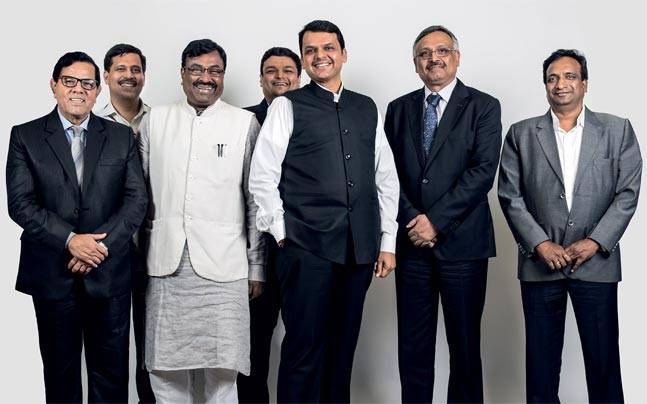 Maharashtra CM Devendra Fadnavis with Finance Minister Sudhir Mungantiwar (in white jacket) and bureaucrats from the state.