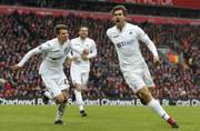Liverpool's title challenge dented by Swansea sensation