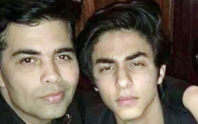 Karan Johar (L) and Aryan Khan