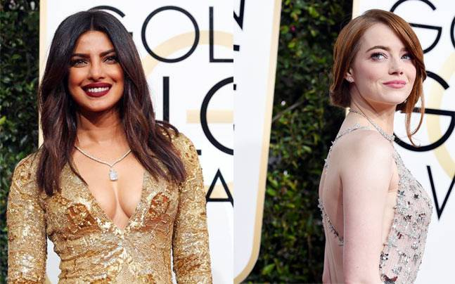 Priyanka Chopra and Emma Stone's hair updos were totally on point. Photo: Reuters   AP