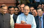 File photo of Finance Minister Arun Jaitley with 2016's Union Budget (Photo: ANI)