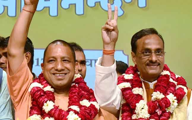 Dinesh Sharma with Yogi Adityanath (PTI photo)
