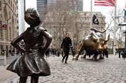 'Fearless Girl' statue stares down Wall Street's iconic Charging Bull