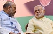 Narendra Modi and Amit Shah are deliberating on next UP CM. Photo: PTI.