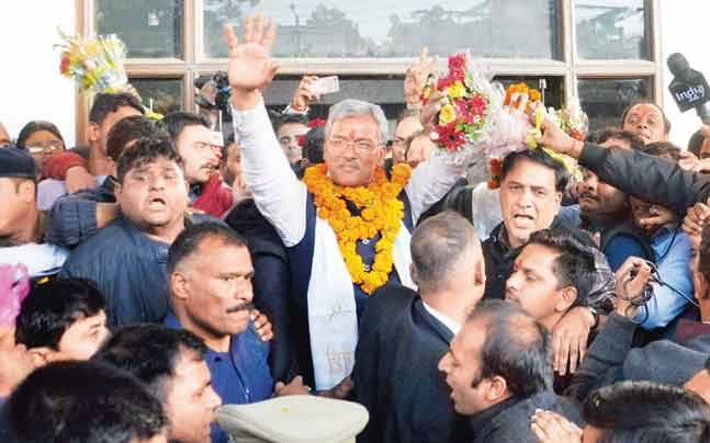 Trivendra Singh Rawat was greeted by supporters after he was elected as the legislative party leader.