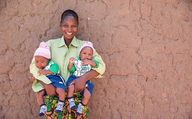 Consolata, a woman who accessed the 'ambulance taxi' service, with her twins. Picture courtesy: Instagram/vodafonefoundation