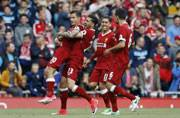 Liverpool F.C. leave for Australia on Champions League high