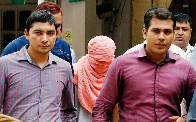 Juvenile accused (face covered) in Nirbhaya gangrape case