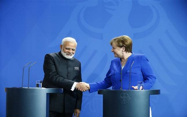 German Chancellor Angela Merkel shakes hands with Indian Prime Minister Narendra Modi following a news conference at the Chancellery in Berlin, Germany, May 30, 2017.