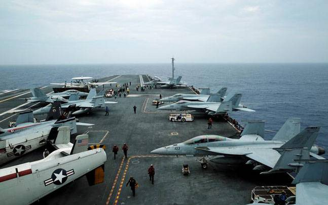 F/A-18 Hornet fighter jets and E-2D Hawkeye plane are seen on the U.S. aircraft carrier John C. Stennis during joint military exercise called Malabar, with the United States, Japan and India participating, off Japan's southernmost island of Okinawa, Japan