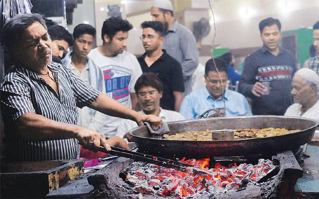 The shop started serving buffalo meat delicacies for the 1st time in last 2 months on Wednesday. Photo: Naeem Ansari