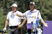 Phil Mickelson, left, with caddie 'Bones' (AP Photo)
