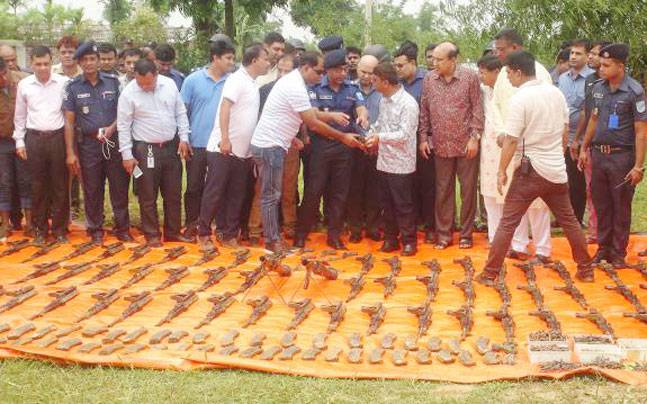 Arms and ammunition recovered from canal in Bangladesh