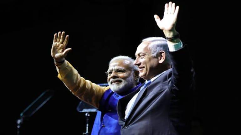 Narendra Modi and Benjamin Netanyahu during a reception for the Indian diaspora in Israel (Reuters photo)