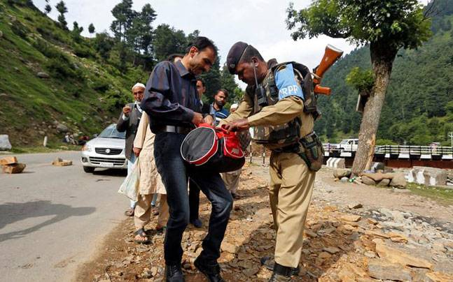 Security personnel stand guard after militants opened fire on the Amarnath Yatra in which some pilgrims were killed in Anantnag in Jammu and Kashmir on Monday. (PTI Photo)